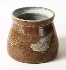 Beige pot with birds