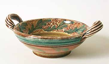 Decorated bowl with handles