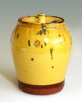 Lidded slipware jar