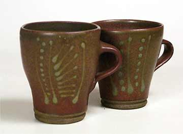 Pair of slip-decorated mugs